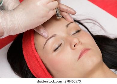 Diamond microdermabrasion peeling on the forehead