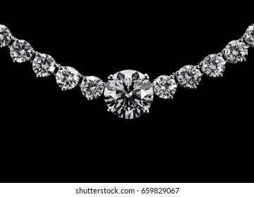 Diamond necklace on black background.