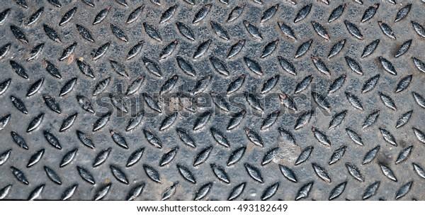 Diamond pattern metal sheet background texture