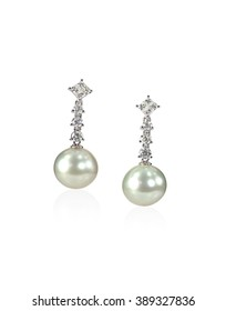 Diamond Pearl drop earrings isolated on white