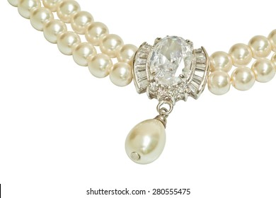 Diamond and pearl necklace isolated on white