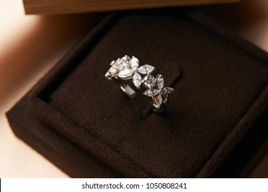 Diamond ring in dark jewel box. Close-up of a jewelry box with elegant gold ring with brilliants, symbol of engagement and elegance