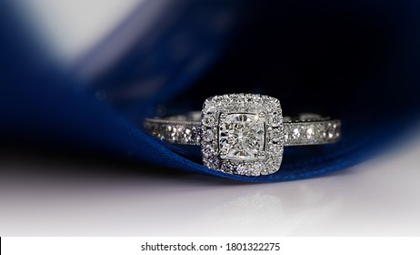 Diamond ring on dark blue background,wedding ring, engagement ring,solitaire