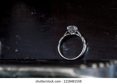 Diamond Ring on Old Skratched Wood