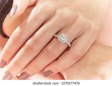 Diamond ring on young woman hand