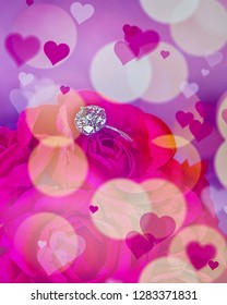 Diamond Ring placed in flowers with a bokeh background and  hearts. Isolated.Composite Image.