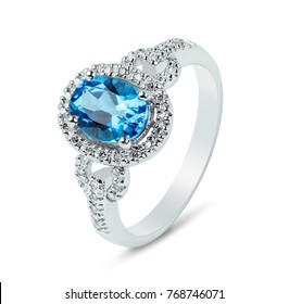 Diamond ring. Diamond ring with topaz isolated on white background. Ring with diamonds and  large topaz.