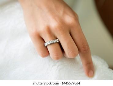 Diamond rings on woman hand