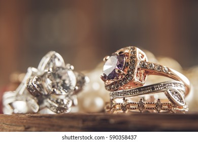 Diamond rings over wood table