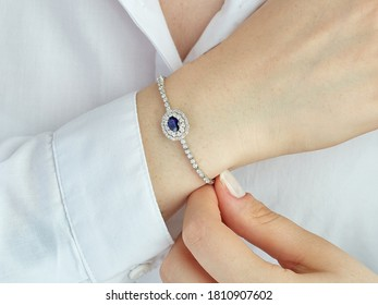 Diamond sapphire bracelet on young women