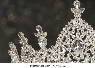 Diamond Silver Crown for Miss Pageant Beauty Contest, Crystal Tiara decorate with many shape of gems stone and bokeh background, HDR stacking Macro photography