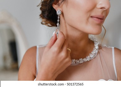 Diamond and silver earring worn by a bride