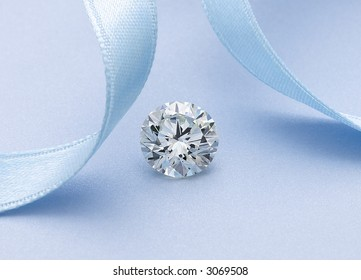 Diamond Solitaire with blue ribbon
