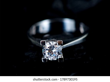 Diamond solitaire ring black background