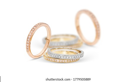 diamond stacked rings group on white background,white gold,yellow gold,rose gold selected focus