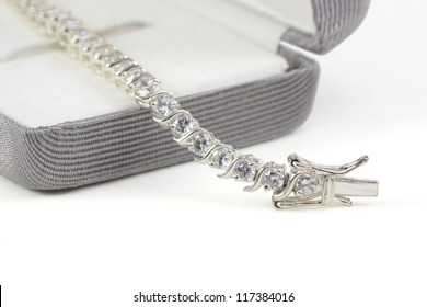 Diamond tennis bracelet in box isolated on white