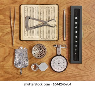 Diamond Tools Jewellery and Gemmology Instruments Collection with Antique Book on Wooden Background