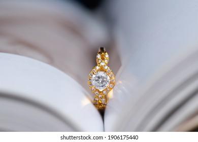 diamond wedding ring inside a book page