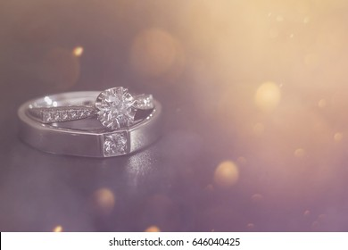 Diamond wedding ring on smoke background