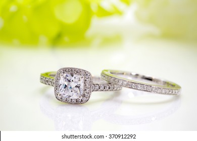 Diamond white gold ring with Flower background