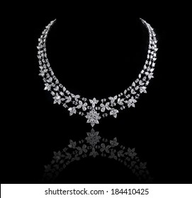 diamonds necklace shot against  a black background