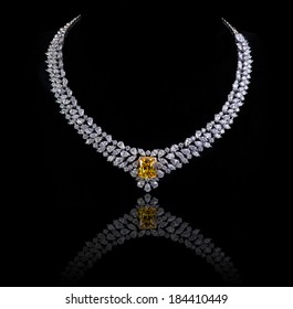 diamonds necklace shot against  a black background