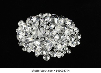 Diamonds on black background. Assortment of white round diamonds.