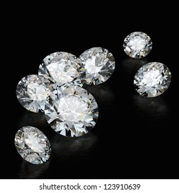 diamonds on a black background with the play of color in the faceting