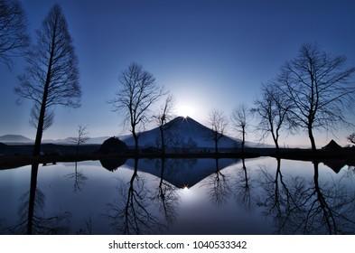 Diamonf Fuji seen from Fumotoppara camping ground, Fujinomiya , Shizuoka prefecture, Japan. Diamond Fuji is View of the sunrise at the summit of Mt. Fuji.