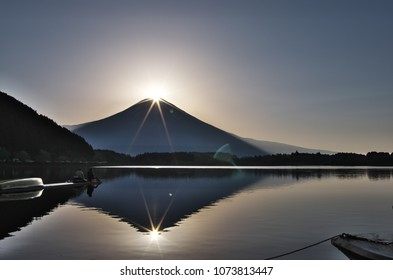 Diamonf Fuji seen from Lake TANUKIKO, Fujinomiya , Shizuoka prefecture, Japan. Diamond Fuji is View of the sunrise at the summit of Mt. Fuji.