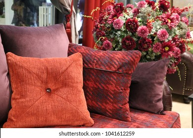 dian with pillows in the same color scheme in the interior