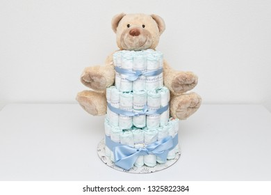 Diaper cake with a teddy bear