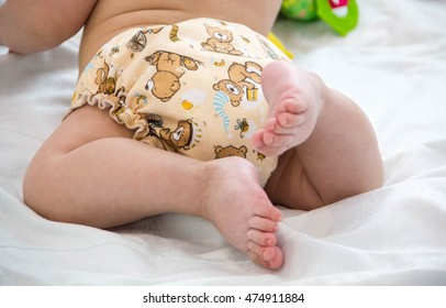 diaper cloth baby hygiene baby modern eco stacks of cloth diapers nappies selective focus close-up on bright background. a beautiful reusable diapers. tiger coloring, dress up Unrecognizable