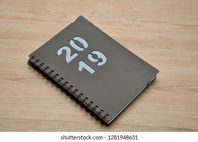 A diary for 2019 on a wooden background