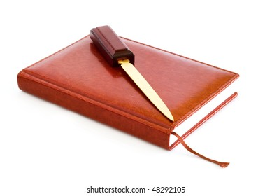 diary of a brown skin, stationery knife, white background