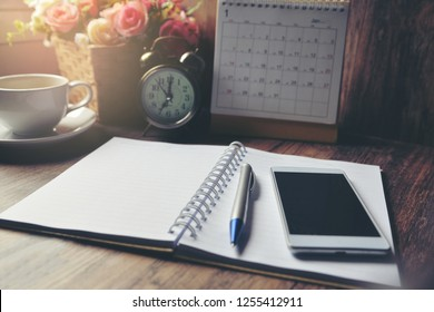 Diary, Calendar and agenda for Event Planner to plan timetable, appointment, organization, management on office table. Desktop Calender and coffee place on wooden desk. Calendar Background Concept.
