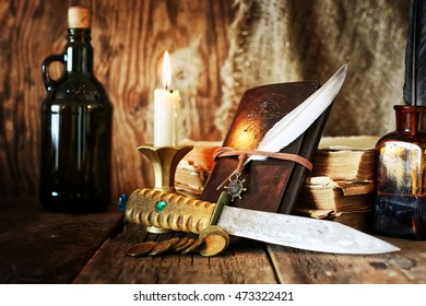 diary and feather with a bottle of rum