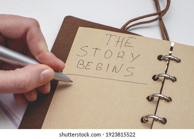 Diary with handwritten text The story begins. Concept of the beginning of a new story.