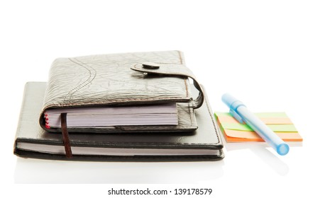 Diary, notepad, scratch paper and the handle isolated on white