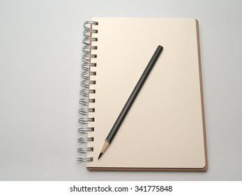 Diary And pencil , Placed on a white background