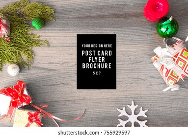 diary post card flyer Christmas composition. Christmas gift, pine cones, fir branches on wooden white background. Flat lay, top view