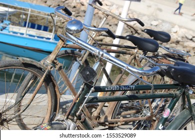 Dibba, Musandam / Oman - Circa December 2018: Vintage bicycles, already rusty, piled up against one another by the water at the port of Dibba.