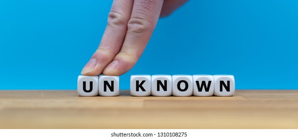 "Dice form the word ""UNKNOWN"" while two fingers push the letters ""UN"" away in order to change the word to ""KNOWN""."