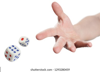 The dice game: hand throwing game cubes, isolated on white background