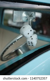 Dice Hanging from Rearview Mirror Through Car Windshield