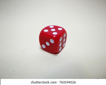 dice isolated with yellowish background.