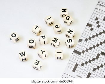 Dice with letters newspaper with crossword on old vintage distressed tabletop with copy space