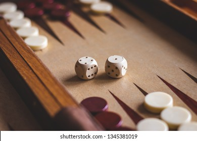 Dice on backgammon board game. Selective focus. Playing leisure games