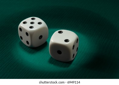 dice on green background with spot light
