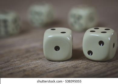 dice on a wooden desk